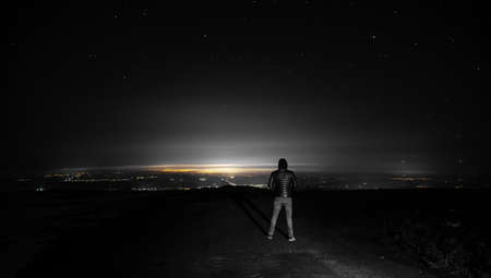 man in high under the stars background Stock Photo