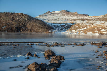 ice lake in mountain under blue sky Stock Photo