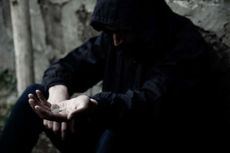 sad man empty hand on dark background