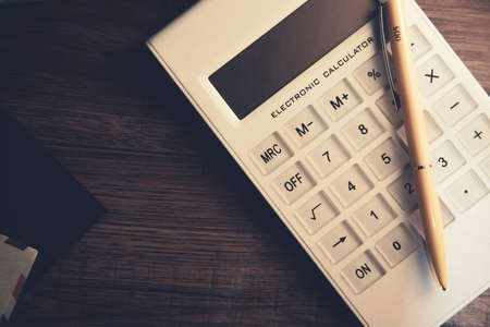 notepad with calculator and letters on desk