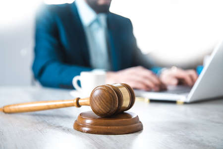 judge with man working on the office table