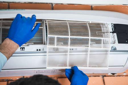 worker man repair air conditioner