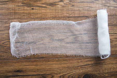 white medical gauze on the wooden table
