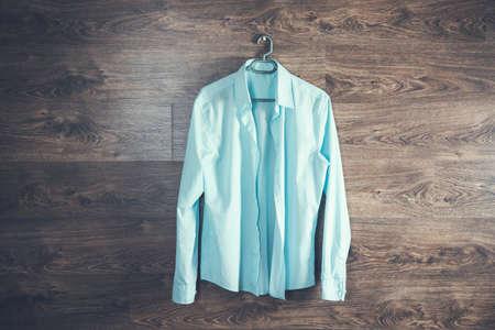 man blue shirt in hanger on dark background 版權商用圖片