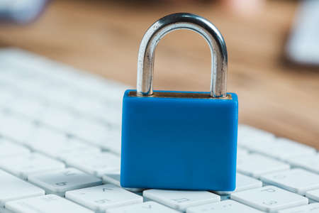 blue lock on the computer keyboard background