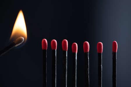 Burning match hot darkness burn on dark background