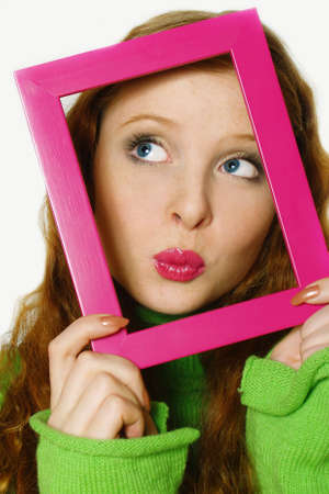 Face of the young beautiful girl in a frame. The kissing girl Stock Photo - 5634724