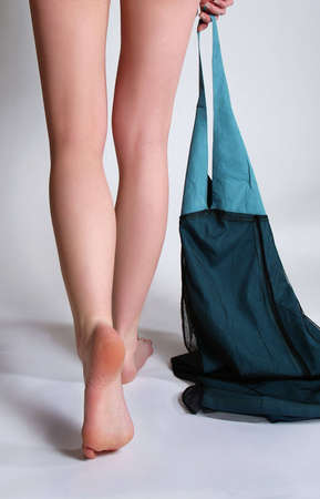 long feet: Beautiful long feet of the undressing girl