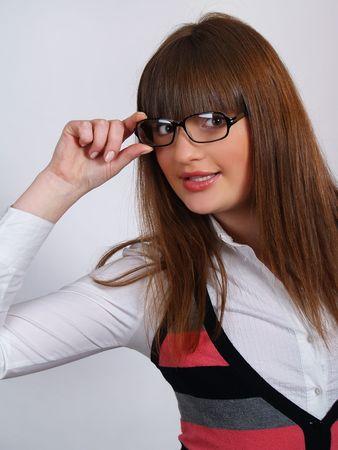 Portrait of pretty brunette girl in glasses speacs          photo