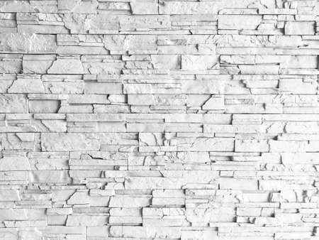 Seamless texture of white decorative stacked stone, natural stone cladding.