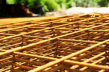 Rusty metal armature net for building construction.