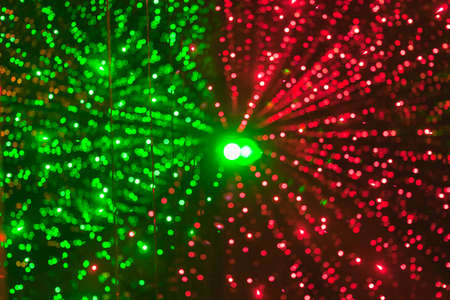 background of green and red bokeh light, diverge from the center of the frame Stock Photo