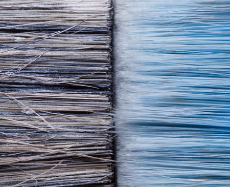 macro shot of two paint brushes - used and clean in blue tones 免版税图像