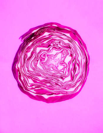 red cabbage in a cut on a pink background 版權商用圖片