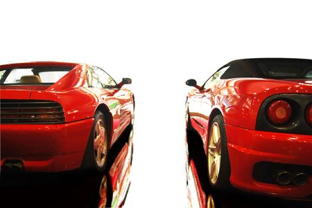 shot  of a two red sports cars (ferrari)