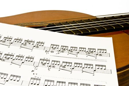 classical (spanish)guitar and music sheet