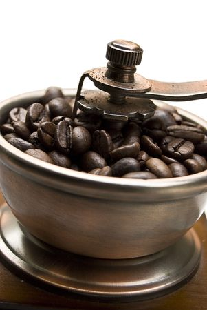 Old-fashioned coffee grinder with coffee beans  isolated over white photo