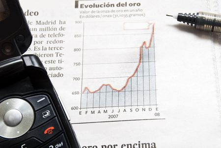 Close up shot of a pen  and phone  on stock price chart. Stock Photo - 2455417