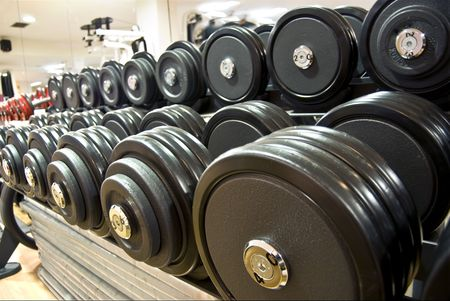 weights, dumbbells in the gym photo