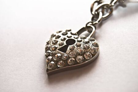 jewelle: heart shaped necklace made of iron , with a bolt in the middle.