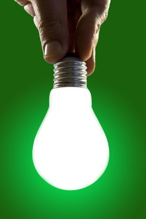 Lightbulb on gradient background. When the hand touch the bulb turn on the light