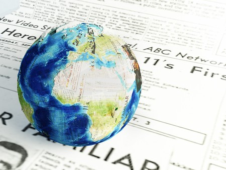 3d render.Global news concept.  earth globe made of differents newspapers on a newspaper page. Stock Photo
