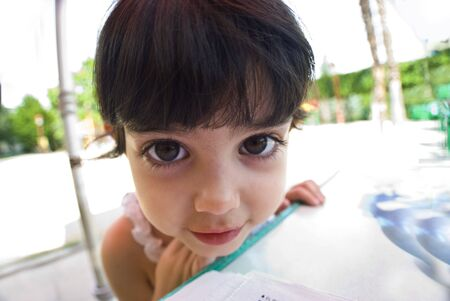 Fun Perspective of a young girl with big eyes. Wide angle shot photo