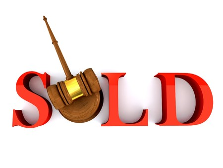 Classic wooden judges gavel and sold word