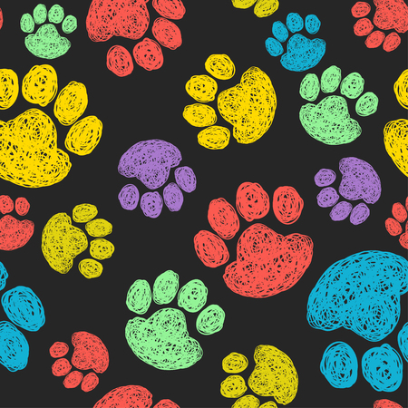 Cute seamless pattern with colorful hand drawn doodle paw prints. Animal tiling background.