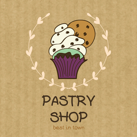 kraft paper: Cartoon cupcake with chocolate chip cookie. Hand drawn doodle muffin in floral frame isolated on brown kraft paper background.
