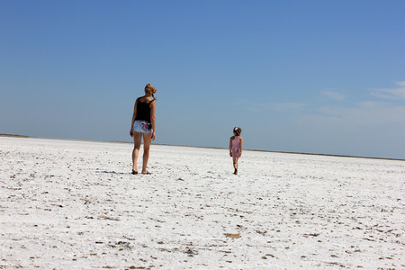 outgoing: Women and girl outgoing to white desert Stock Photo