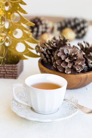bumps: Christmas composition with cup of tea, bumps and xmas tree Stock Photo