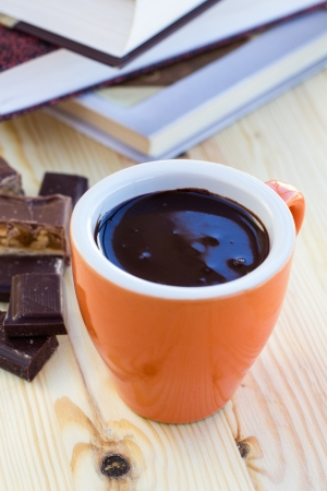Cup of hot chocolate on wooden surface photo
