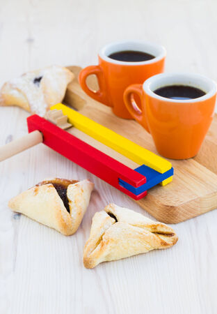 hamantaschen: Hamantaschen cookies for Purim on a wooden table