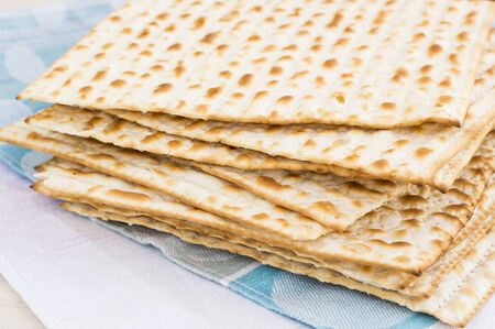 matzot: Matzot for passover celebration on a wooden surface