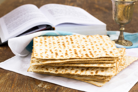 matzoth: Matzo and wine for passover celebration on a wooden surface