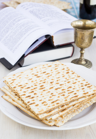 Matzo and wine for passover celebration on a wooden surface photo