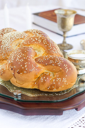 Set for Shabbat with challah bread on a wooden table photo