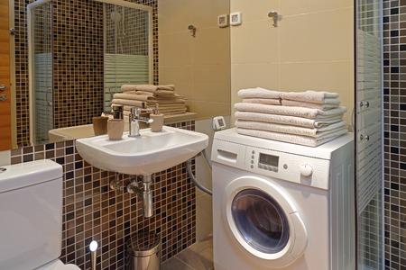 bathroom interior: Interior of small bathroom with washing machine