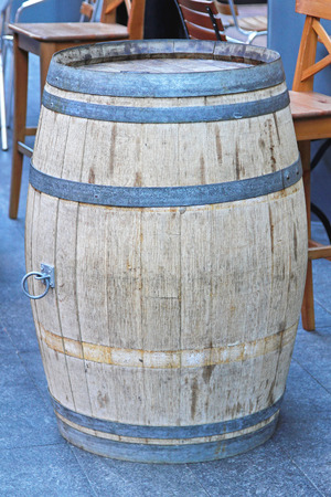 caffee: Old oak barrel in front of caffee