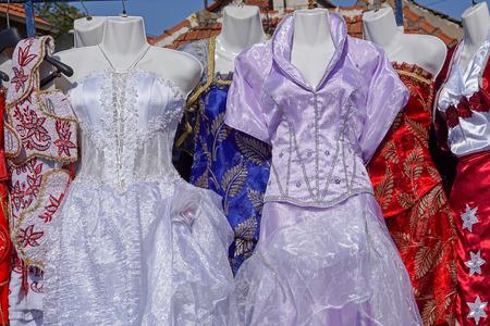 second hand: Second hand festive dresses at flea market Stock Photo