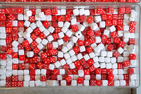 pendants: Red and white plastic dice pendants Stock Photo