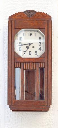 pendulum: Wooden grandfather clock with pendulum at wall
