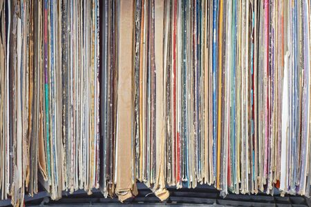 second hand: Stacked second hand vinyl records at flea market