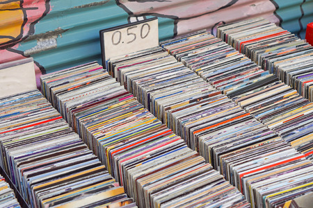 cds: Used CDs for sale at flea market Stock Photo