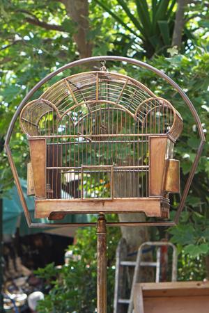 birdcage: Antique style metal birdcage at pole