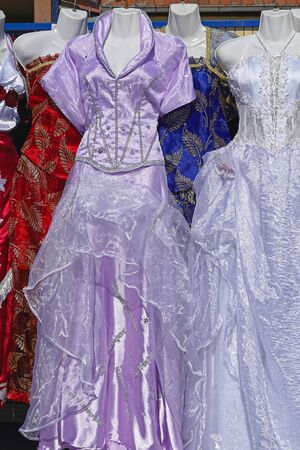 second hand: Second hand festive dresses at flea market Stock Photo
