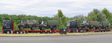 stopped: ROSZKE, HUNGARY - JULY 09, 2015: Kfor convoy stopped at border crossing in Roszke, Hungary. Transport of military truck at checkpoint between Serbia and Hungary.