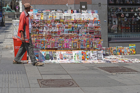periodical: VIENNA, AUSTRIA - JULY 12, 2015: Newspaper vendor at street stand in Wien. Colorful Newspapers and Periodical for sale at Graben Street in Vienna, Austria. Editorial