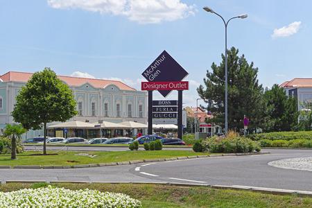 gucci shop: PARNDORF, AUSTRIA - JULY 10, 2015: McArthur Glen Designer Outlet in Parndorf. Famous discount shopping village near Vienna.
